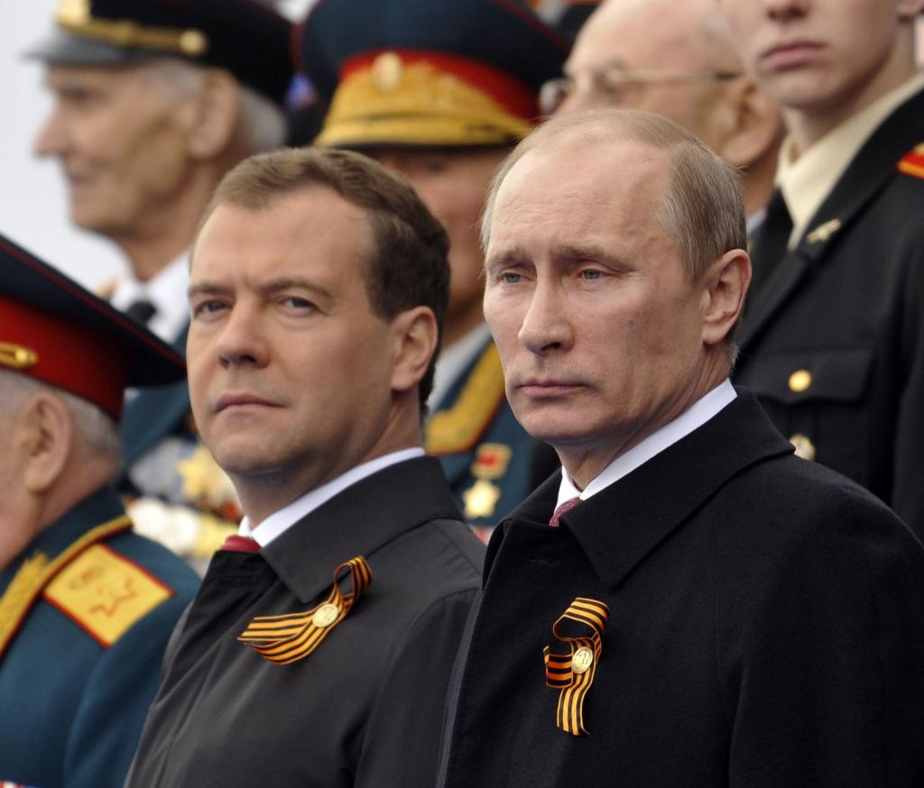 Russian President Dmitry Medvedev (L) and Prime Minister Vladimir Putin attend a military parade