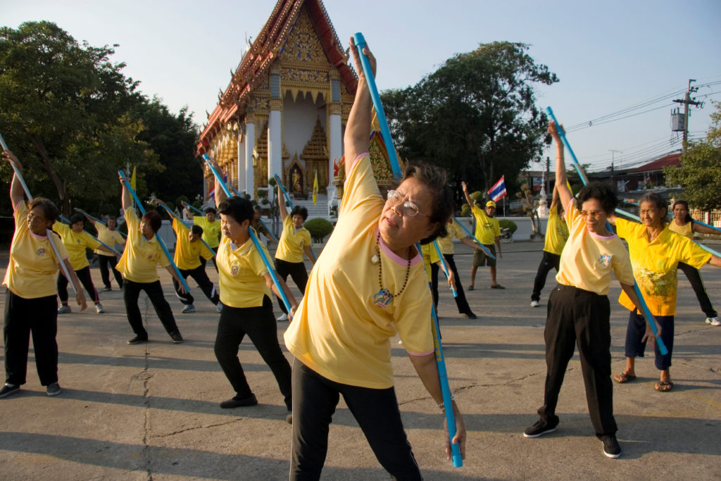 "Elderly residents exercise at Wat Kae Nok Buddhist temple. Wat Kae Nok temple is among hundreds of Buddhist temples nationwide participating in the ""Health Promotion Temple"" project. The campaign was initiated in 2003 by the Public Health Ministry's Department of Health as part of the ""Healthy Thailand"" agenda, aimed at highlighting the importance of physical and mental well-being of the population. Credit: Vinai Dithajohn/OnAsia.com Contact: sales@onasia.com Legal Notice: Any use of this picture is subject to a license agreement entered into by the user and OnAsia Images Ltd. All other rights reserved. Any re-use and redistribution of this image is prohibited. For sales enquiries regarding any additional use of this or other pictures from OnAsia Images please contact sales@onasia.com"
