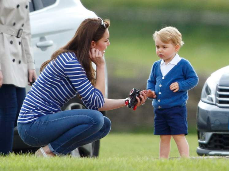Catherine, Duchess of Cambridge and Prince George of Cambridge attend the Gigaset Charity Polo Match