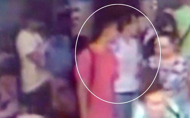 Still image from closed-circuit television (CCTV) footage released by Thai police shows what they believe to be two new suspects