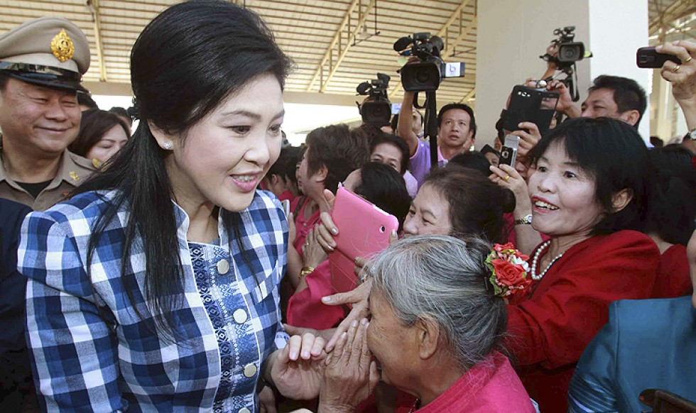 Supporters greet Thailand's Former Prime Minister Yingluck Shinawatra (front left) in the northern town of Chiang Rai