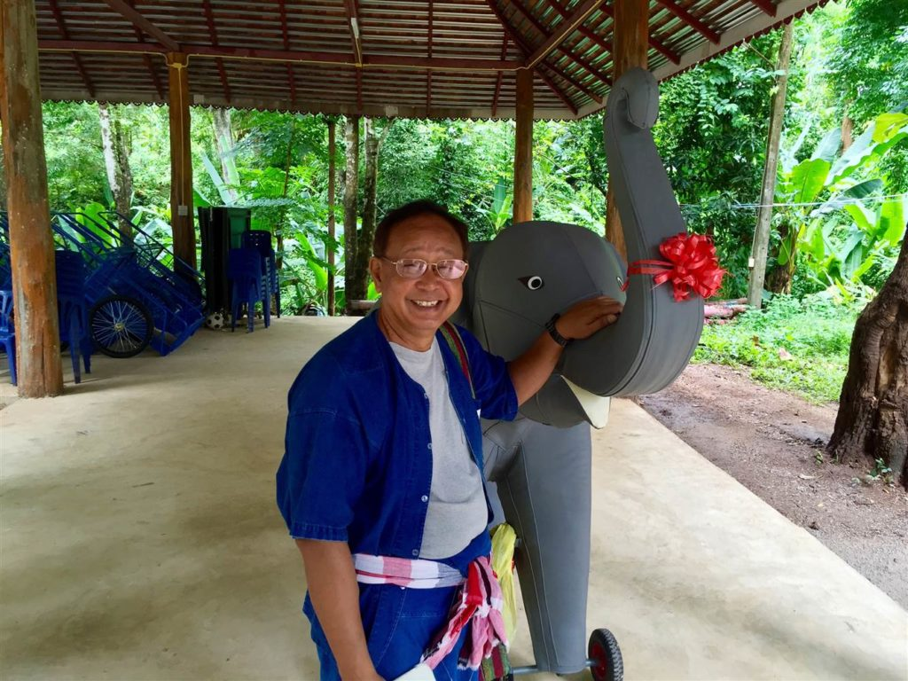 Prasop Tipprasert, the founder of the program, with a model elephant he uses to first teach kids how to ride