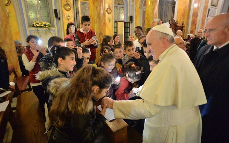 Pope Francis meets with young refugees from Syria and Iraq during his trip to Turkey