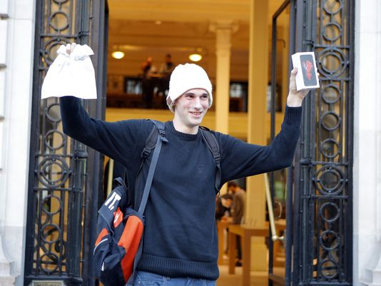 Jonathan Pierrard, 26, from Rossignol, Belgium is the first customer to leave with the new iPhone 6S at The Apple Store in Paris, after waiting in line since Thursday night.