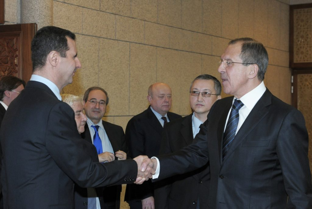 Syrian President Bashar Assad, left, shakes hands with Russian Foreign Minister Sergey Lavrov after talks in Damascus, Syria.