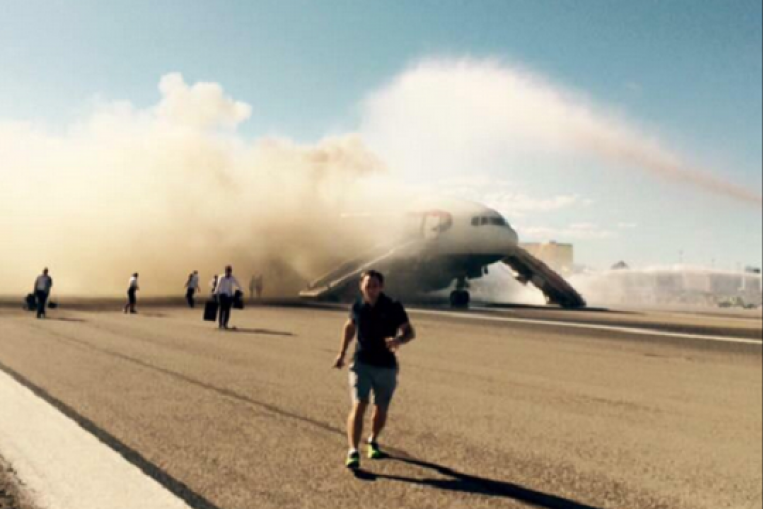 People running away from the British Airways plane that caught fire.