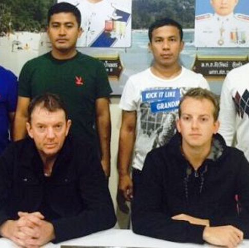 New Zealanders Brian Russell Finn, 54, and his son Luke, 24, were arrested on arrival at Phuket Airport last night. Photo: Kathu Police - See more at: http://www.thephuketnews.com/new-zealand-father-and-son-arrested-at-phuket-airport-over-patong-restaurant-bill-54122.php#sthash.rUmBtuWS.dpuf