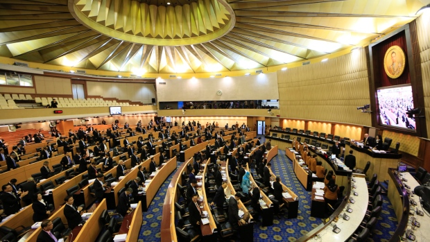 Thailand's legislature, known as the National Reform Council, stands after they votee 135 against vs. 105 in favor with seven abstentions on the new draft constitution Sunday, Sept. 6, 2015, in Bangkok, Thailand. (AP / Wason Wanichakorn)