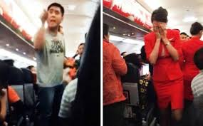 Chinese tourists behaving badly on a flight from Bangkok, who left a stewardess (right) in tears in 2014