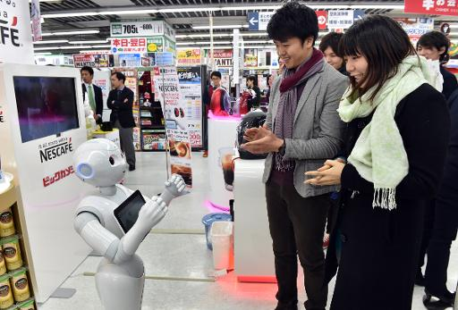 Japanese telecom giant Softbank's humanoid robot Pepper introduces customers to Nestle's coffee machines