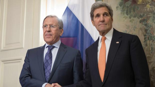 US Secretary of State John Kerry (R) shakes hands with Russian Foreign Minister Sergey Lavrov