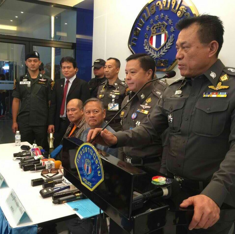 Seated from left to right: Mario Reyes, Joel Reyes, flanked by Thai police