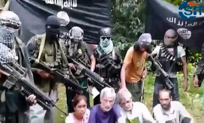 Canadian and Norwegian Hostages in Southern Philippine's Plead for their Lives in YouTube Video