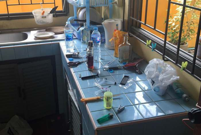 Knives and alcohol bottles were found on the kitchen counter. Photo: Winai Sarot