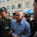 Pol Maj Prakrom Warunprapa, one of the three lese majeste suspects, is taken for detention at the Bangkok Military Court