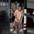 Myanmar migrant workers Zaw Lin and Win Zaw Htun arrive at the Koh Samui Provincial Court