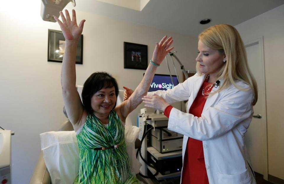 Dr. Jill Waibel examines Kim Phuc before the first of several laser treatments to reduce pain and the appearance of burn scars in her back and left arm in Miami. Phuc was injured by a napalm bomb in Vietnam 40 years ago Read more here: http://www.miamiherald.com/news/local/community/miami-dade/article41630079.html#storylink=cpy