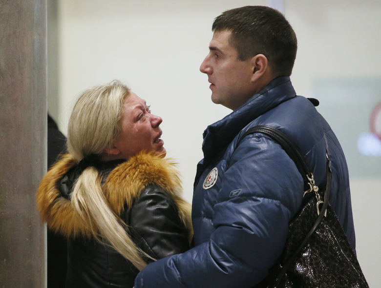 Relatives react after a Russian airliner with 217 passengers and seven crew aboard crashed, as people gather at Russian airline Kogalymavia's information desk at Pulkovo airport in St.Petersburg
