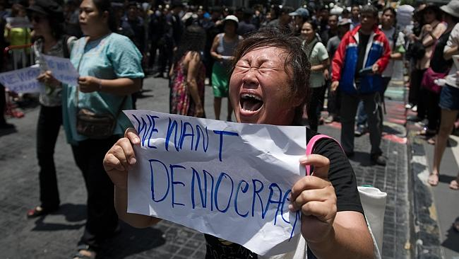 Demanding democracy ... a woman screams at soldiers during an anti-coup protest in Bangkok.