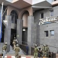 epa05035029 Security forces surround the Radisson Hotel during a hostage situation, Bamako, Mali