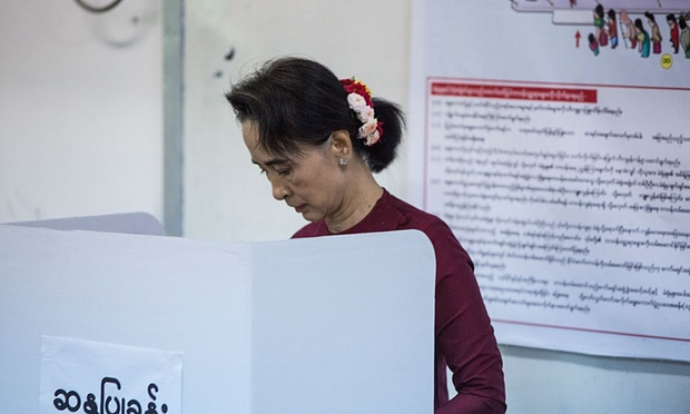 Aung San Suu Kyi, the Myanmar opposition politician, casts her vote during the first free and fair election for decades on Sunday. Photo - Lam Yik Fei