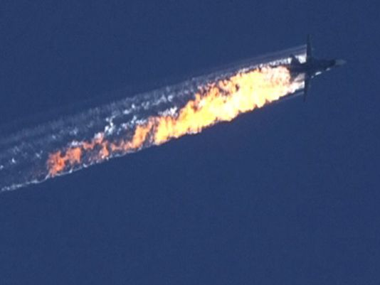 a burning trail as a plane comes down after being shot down near the Turkish-Syrian