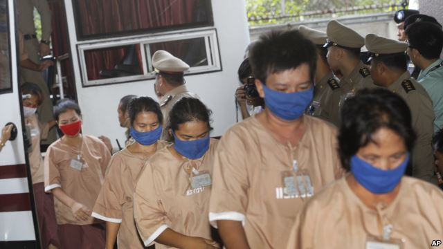 Female suspects allegedly involved in human trafficking of Rohingya migrants file into the Criminal Court in Bangkok