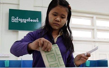 A Burmese woman casts her vote in the capital Naypyitaw, Myanmar