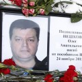 Russian Lt. Col. Peshkov's body is on its way through Turkey to be flown back to Russia despite a slew of sanctioned approved by Putin Saturday.