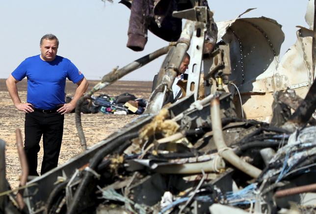 Russian Emergencies Minister Vladimir Puchkov looks at debris from a Russian airliner at its crash site at the Hassana area in Arish city.