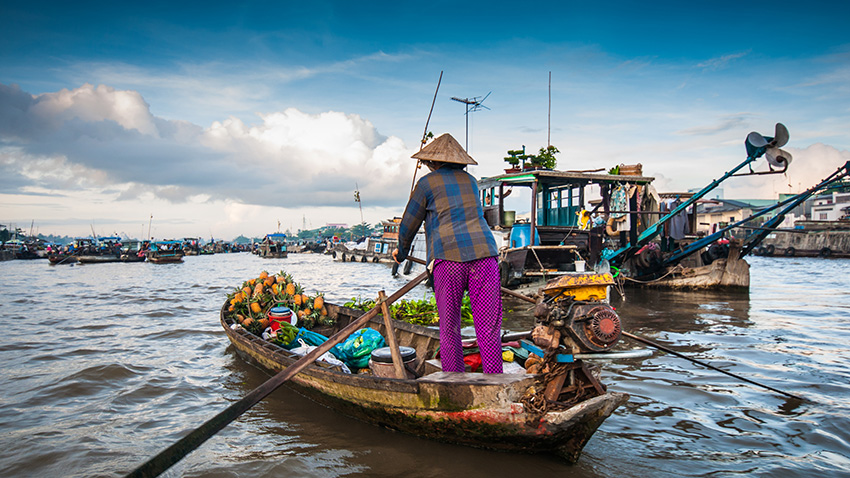 Cai Rang, one of the largest floating fruit and vegetable markets in Vietnam's Mekong Delta, is a popular tourist attraction