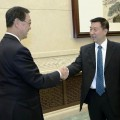 Chinese State Councilor Wang Yong (R) shakes hands with visiting Thai Deputy Prime Minister Pridiyathorn Devakula