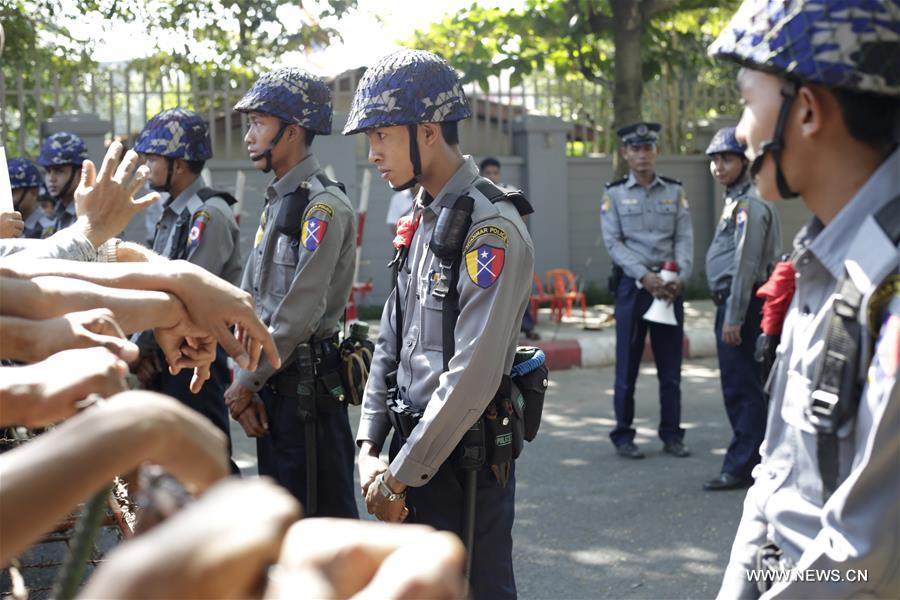 Myanmar police officers stand guard outside the Thai Embassy in Yangon