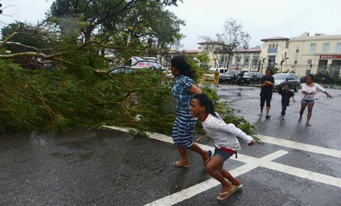 Typhoon Melor has ripped through the central Philippines, bringing heavy rain and strong winds that left at least four people dead and millions without power, officials say
