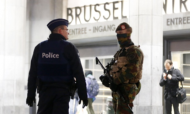 Police officers in front of the central station in Brussels on Monday. Six people were taken for questioning but four later released.