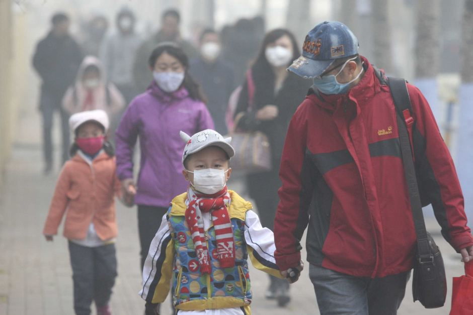 Chinese residents wearing face masks on a street in Beijing