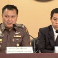 Pol Maj Gen Kornchai Klaiklung, left, the head of the anti-human trafficking wing of the police, and government spokesman Sansern Kaewkamnerd, right, speak at a news conference in Bangkok Monday