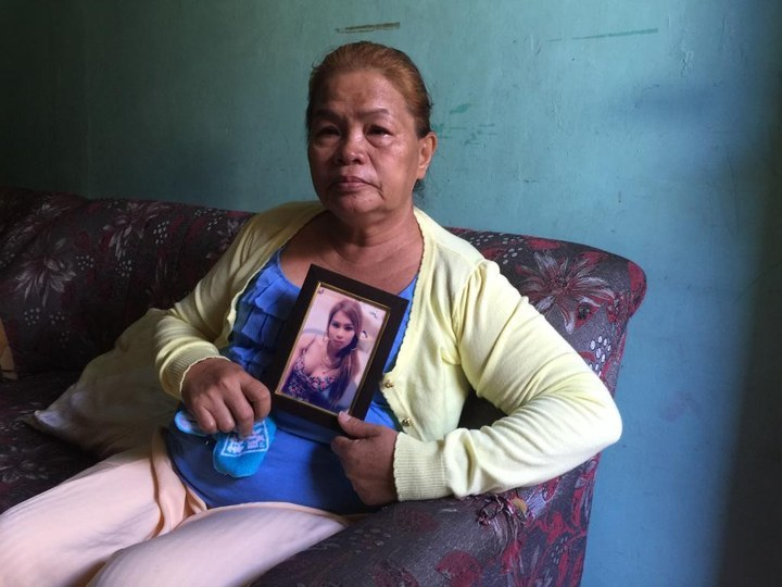 Jennifer Laude's mother, Julita Cabilan, holds her photograph shortly before heading to the courthouse for the expected verdict in Pemberton's trial.