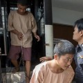 Myanmar migrant workers Zaw Lin (C) and Wai Phyo (L), also known as Win Zaw Htun, arrive at the Koh Samui Provincial Court, in Koh Samui, Thailand
