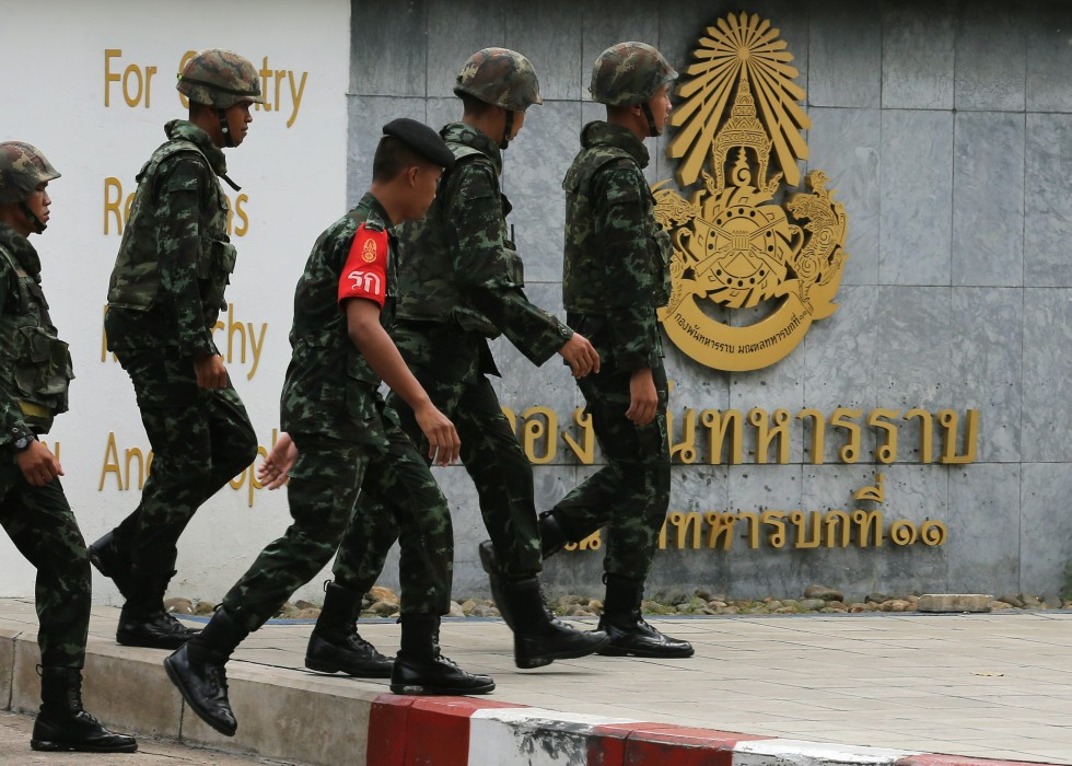 Soldiers walk in front of the military base, in Bangkok, Thailand,