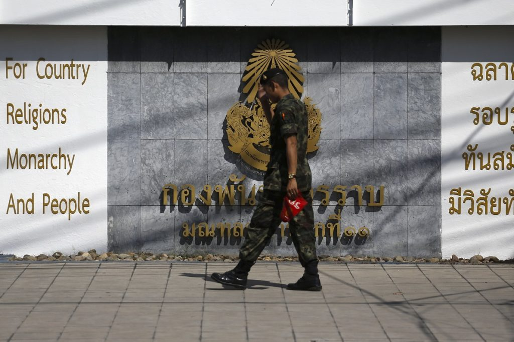 A soldier walks outside the 11th Army Circle base in Bangkok, Thailand, December 29, 2015. A soldier walks outside the 11th Army Circle base in Bangkok, Thailand,