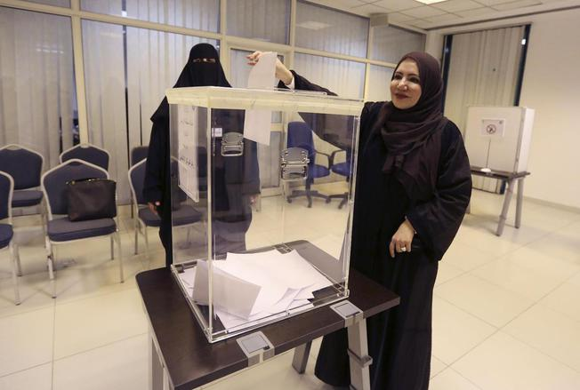 Saudi women vote at a polling center during the country's municipal elections in Riyadh, Saudi Arabia,