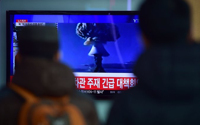 People in Seoul, South Korea, watched a news report on North Korea's announcement of its first hydrogen bomb test on Wednesday. Credit Jung Yeon-Je/Agence France-Presse