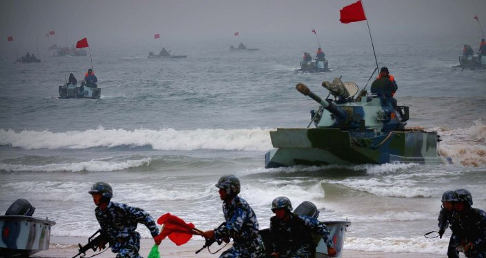 "Amphibious tanks and Marine Corps soldiers rush to the beachhead in an amphibious landing drill during the third phase of the Sino-Russian ""Peace Mission"