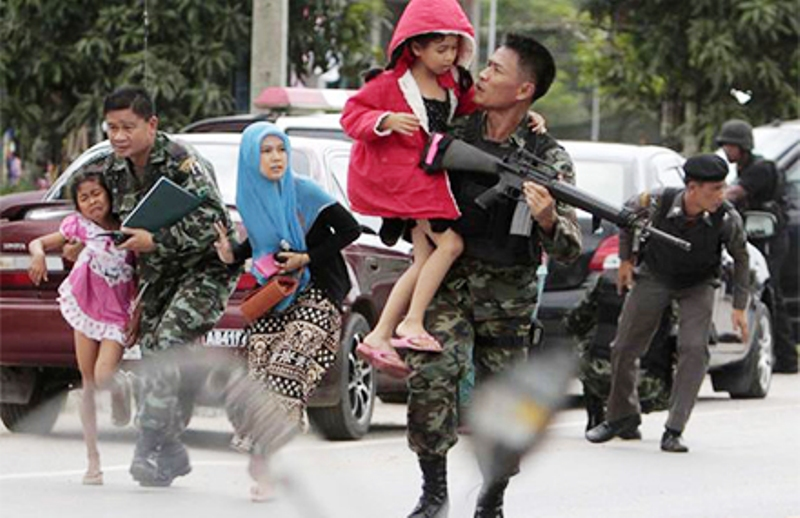 Thai soldiers rush children to protection in Thailand's deep south