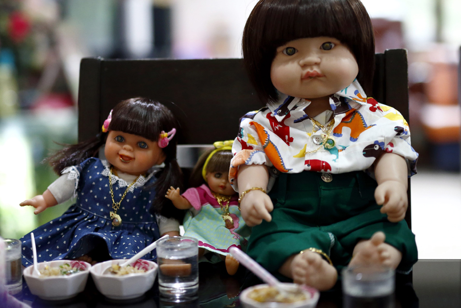 Child Angel dolls are being offered food and drinks by their owner