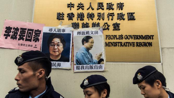 Missing person notices of Gui Minhai (L), one of five missing booksellers from the Mighty Current publishing house and Yau Wentian (R), a Hong Kong publisher who was jailed last year while preparing to release a book critical of President Xi Jinping