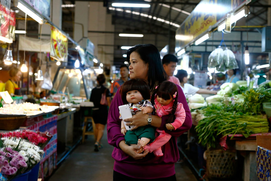 Ratchada has been pictured with her dolls as she does everyday tasks, such as shopping for food at a market in Bangkok
