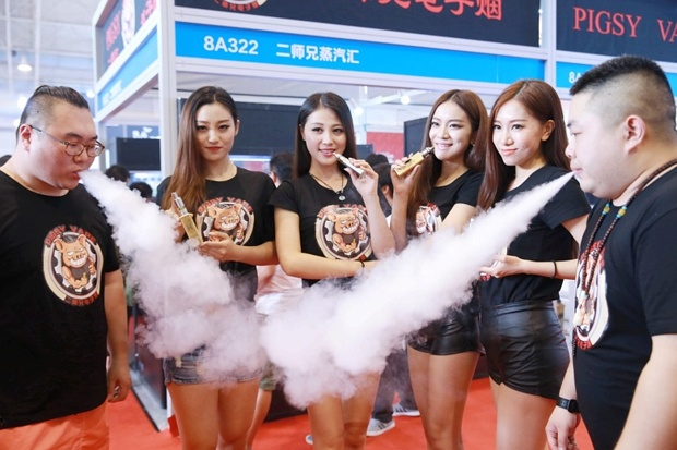 Models at the Vape China Expo 2015 target the country's 300 million smokers with brands such as 'Pigsy Vape'