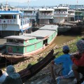 Dock workers waiting to unload Chinese boats in Chiang Saen